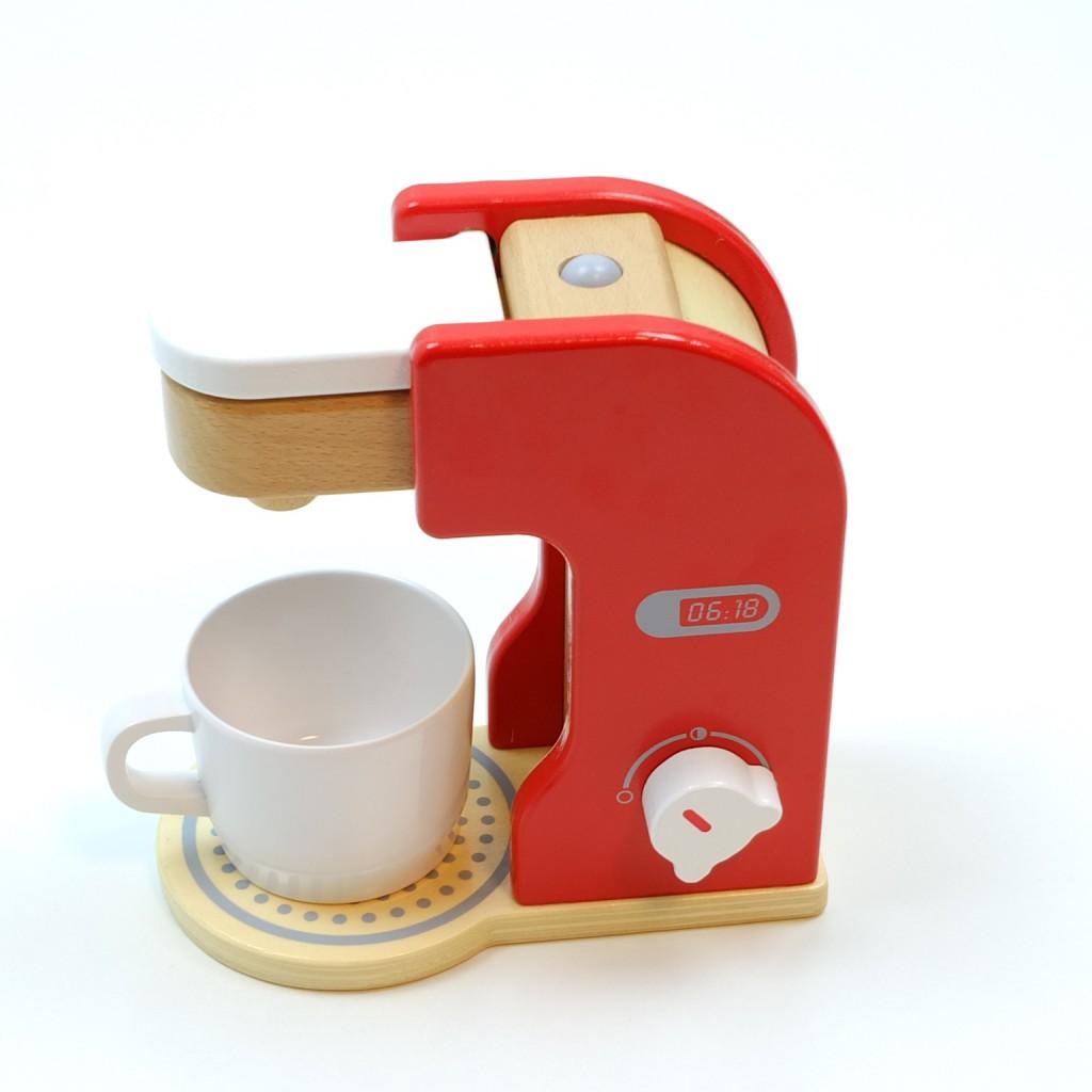 kaffeemaschine mit kaffeepad kaffeetasse und drehbarem schalter mit klickger uschen material. Black Bedroom Furniture Sets. Home Design Ideas
